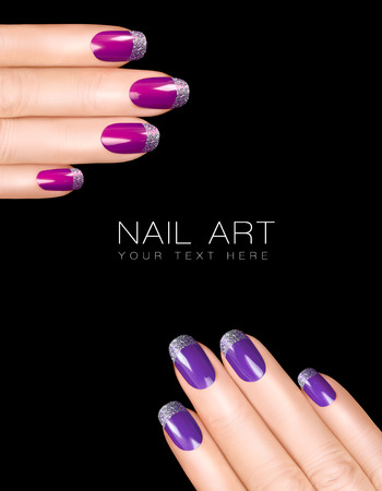 Holiday Nail Art. Luxury purple nail polish with glitter French manicure in silver. Manicure and makeup concept. Closeup hands isolated on black with sample text