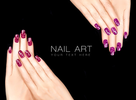 manicured: Colorful Nail Art. Trendy crackle nail polish in reds. Manicure and nail tattoo trend. Closeup of woman hands isolated on black background