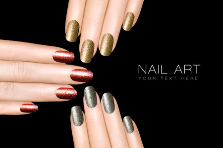 manicured hands: Holiday Nail Art. Trendy glitter nail polish in silver, gold and burgundy red . Manicure and nail art concept. Closeup hands isolated on black with sample text