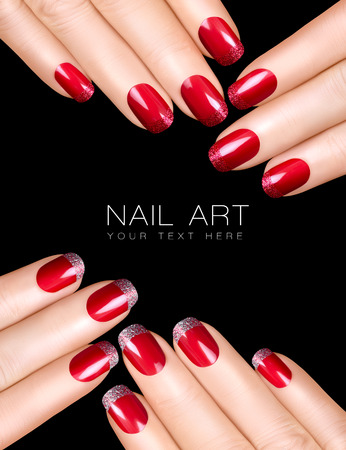 french manicure: Holiday Nail Art. Luxury nail polish with glitter French manicure. Manicure and makeup concept. Closeup hands isolated on black with sample text