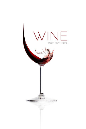 Red wine. Splash design. Wineglasses isolated on white with sample text Stock Photo