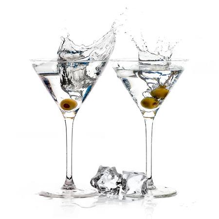 martini splash: Two dry martini glasses. Cocktails isolated on white background. Splash