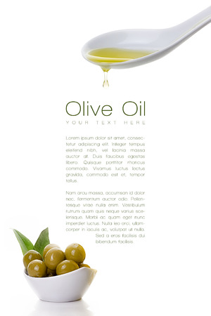 Healthy virgin olive oil dripping from a white ceramic spoon on a sample text with olive seeds on white bowl at the bottom left. Template desing isolated on white