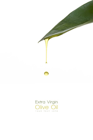 Olive oil dripping from a fresh green leaf. Spa beauty concept. Template design with sample text