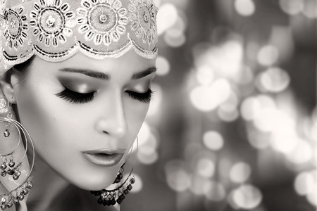 asian bride: Ethnic Beauty Fashion. Closeup hindu face woman with traditional clothes, jewelry and makeup. Monochrome portrait with copy space for text