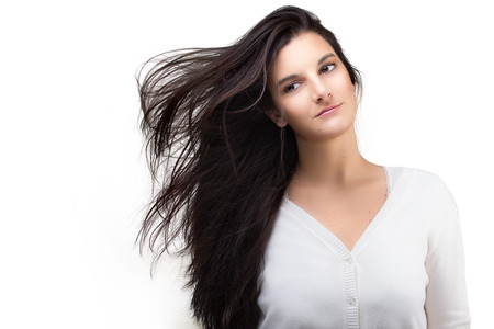 hair studio: Beautiful Teenager Girl with Air Blown Hair. Healthy long hair. Beauty fashion portrait over white background with copy space Stock Photo