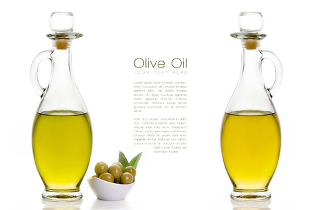Two kinds of Olive Oil on Two Glass Bottles with Olive Seeds on White Bowl at the Left Side. Isolated on White Background. Design Template with Sample Text at the Center