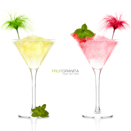 Lemon and Grapefruit Granita. Exotic cocktails garnished with fruit and fresh mint leaves in tall elegant conical martini glasses with ice conceptual of a tropical vacation, nightclub or celebration. photo