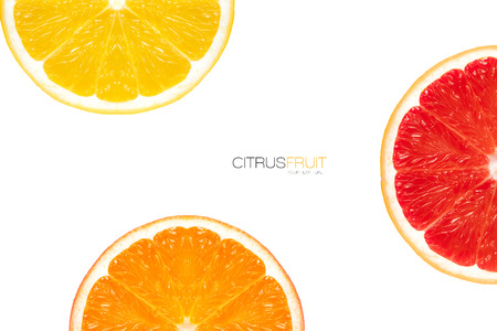 Three different varieties of orange slice arranged around the frame displaying halves showing the segments and traditional orange fruit and red flesh of the blood orange on white with copyspace. Template design with sample text.
