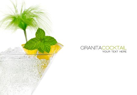 Close up granita cocktail garnished with lemon and mint in a conical martini glass with ice conceptual of a tropical vacation, nightclub or celebration over white background. Template design with sample text photo