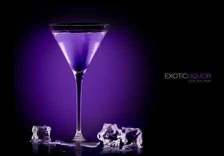 abstract liquor: Stemmed cocktail glass with blackberry liquor and ice cubes on the table, close-up isolated on black. Template design with sample text