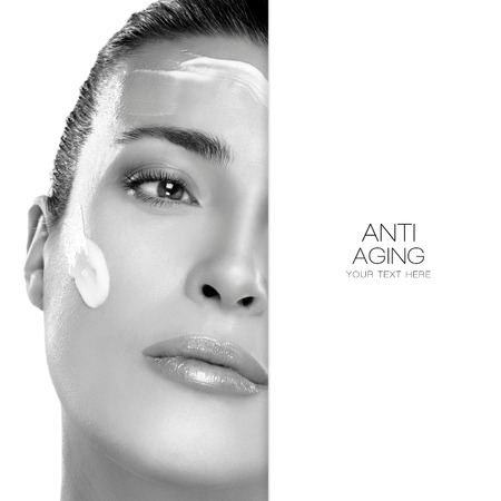 aging face: Anti Aging and beauty concept with a half face portrait of a gorgeous woman with cosmetic cream on her cheek and forehead and blank copyspace alongside with sample text. Spa treatment. Template design