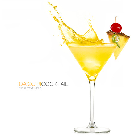 Frozen pineapple daiquiri cocktail with big splash isolated on white background. Design template with sample text