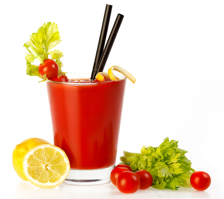 tomato cocktail: Delicious fresh tomato cocktail made with freshly squeezed tomato, lemon and parsley served in a glass with a celery stick, isolated on white with copyspace
