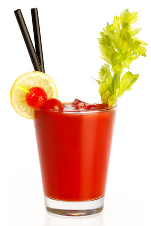 Delicious fresh tomato juice made with freshly squeezed tomato, lemon and parsley served in a glass with a celery stick, isolated on white. Healthy diet concept