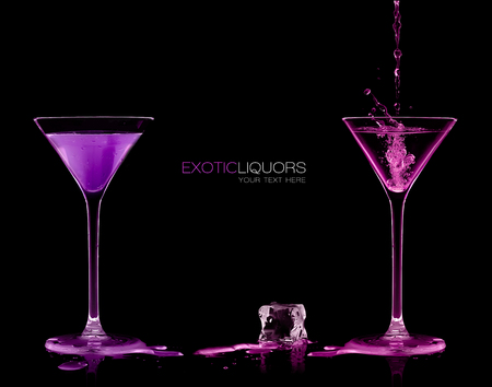 cocktail glasses: Pouring colorful alcoholic drink in stemmed cocktail glasses and splashing out, close-up isolated on black. Template design with sample text Stock Photo