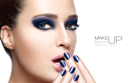 Beauty and Makeup concept with Beautiful young woman with hands on her face covering mouth. Perfect skin. Trendy nail art and makeup. Close up Portrait isolated on white with sample text