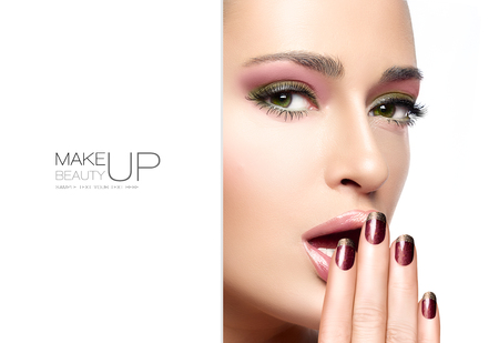nail art: Beautiful young woman with hands on her face covering her mouth. Perfect skin. Nail art and makeup concept. Autumn winter trendy make-up. High fashion Portrait isolated on white. Template design with sample text