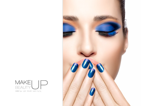 Nail art and makeup concept. Beautiful young woman with hands on her face covering her mouth. Perfect skin. Trendy make-up. High fashion Portrait isolated on white. Template design with sample text Фото со стока