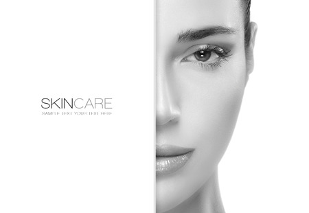 Beauty and skincare concept with a half face portrait of a gorgeous woman with healthy clean skin and blank copyspace alongside with sample text. Template design Banque d'images