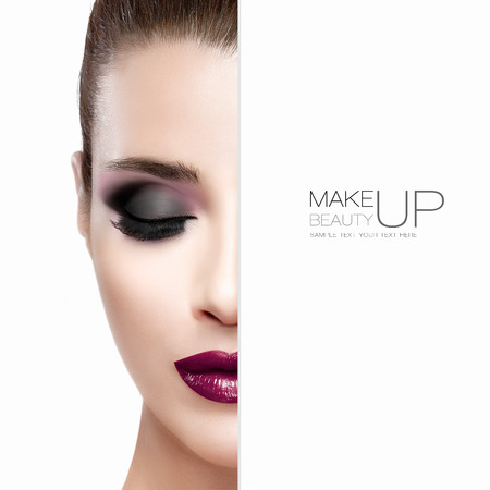 Schoonheid en make-up concept met halve gezicht van een mooie jonge vrouw met gesloten ogen. Perfecte huid. Trendy bordeaux lippen en smokey eyes. Modieuze wimpers. High fashion portret geïsoleerd op wit met voorbeeldtekst Stockfoto