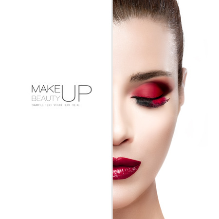Beauty and Makeup concept with half face of a beautiful young woman with eyes closed. Perfect skin. Trendy burgundy lips and smoky eyes. Fashionable eyelashes. High fashion portrait isolated on white with sample text Stok Fotoğraf