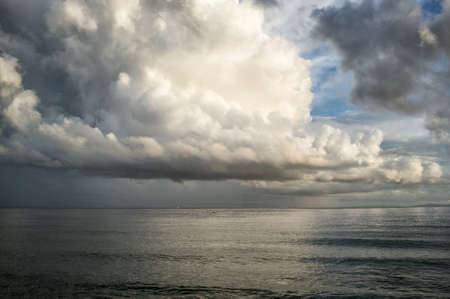 storm background: After storm. Spectacular towering white cumulonimbus cloud formation formed in the sky above Atlantic ocean in a weather and nature background Stock Photo