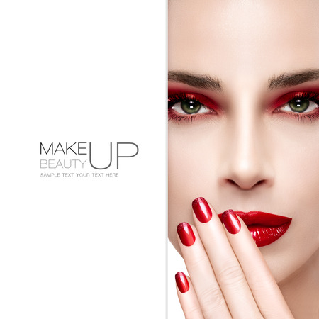 Beauty and Makeup concept. Beautiful fashion model woman with bright make-up. Trendy red lips and smoky eyes. Long eyelashes. High fashion portrait. Blank copyspace alongside and sample text. Template design
