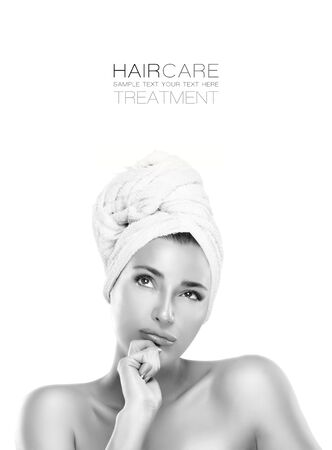 hair treatment: Haircare treatment and beauty concept with a gorgeous young woman looking thoughtfully up into the air with her hair tied in a towel. Haircare and spa concept. Closeup portrait isolated on white with sample text copyspace