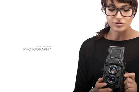 woman with camera: Beautiful Young Woman Wearing Black Clothes and Glasses Capturing Photo Using Vintage Camera. Isolated on White Background with Sample Text Copy Space