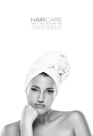 pouty: Haircare and beauty concept. Close up of the face of a gorgeous young woman with her hair tied in a towel, bare shoulders a bored expression looking at camera. Monochrome toned portrait isolated on white with sample text copy space