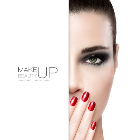 unblemished: Beauty, nail art and makeup concept with a gorgeous fashion model woman with unblemished skin wearing smoky eye makeup holding her hand with manicured red nails to her mouth, white card template over half the face