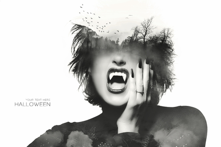 Halloween concept with a Gothic girl with dark clothes and nails wearing vampire teeth with a double exposure of flying bats above an eerie forest over her forehead, isolated on white with sample text