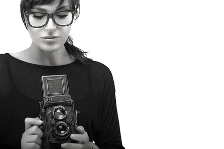 57ee26e8b8 Beautiful Young Woman Wearing Black Clothes with Glasses Capturing Photo  Using Vintage Camera. Black and