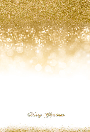 gold colour: Christmas background with golden glitter scattered on top and slightly at the bottom over white background with copy space for your greeting