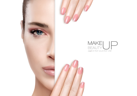 Beauty Makeup and Nai Art Concept. Beautiful fashion model woman with soft pink smoky eye makeup, foundation on a unblemished skin and trendy pink lipstick to match her manicured nails, half face with a white card template. High fashion portrait isolated
