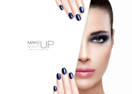 Beauty Makeup and Nai Art Concept. Beautiful fashion model woman with smoky eye makeup in blue to match her manicured nails, foundation on a unblemished skin with trendy pink lipstick, half face with a white card template. High fashion portrait isolated o