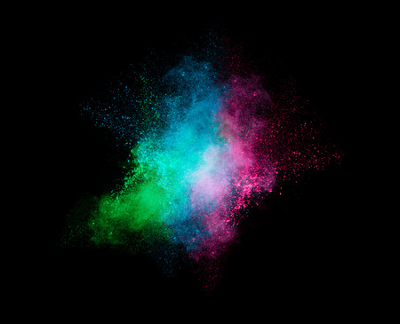pyrotechnic: Colorful dust particle explosion resembling a pyrotechnic effect over black background. Closeup of a color explosion isolated on black