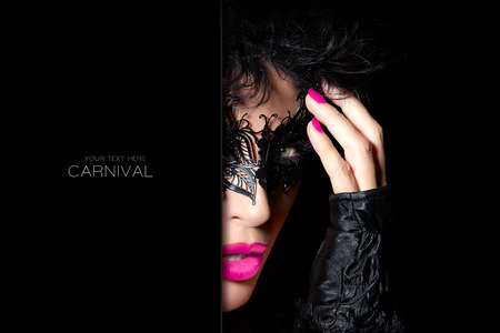 fingerless gloves: Masquerade. Beauty model woman in creative masquerade eye makeup with black detail, closeup half face portrait with raised hand in fingerless gloves. Fashion, beauty and makeup concept. Template design with sample text