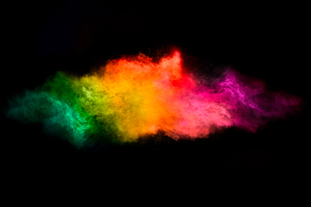 Color explosion. Abstract design of a dust cloud. Colorful rainbow of dust particles isolated on black background