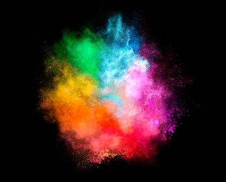 Colorful dust particle explosion resembling a pyrotechnic effect over black background. Closeup of a color explosion isolated on black