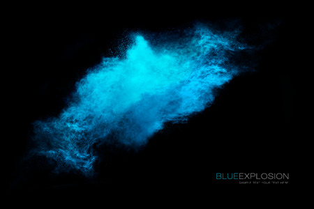 explosion: Blue dust particle explosion resembling snow or water over black. Closeup of a color explosion isolated on black with sample text Stock Photo