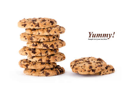 choc: Stack of delicious freshly baked crunchy homemade choc chip cookies with two loose ones alongside isolated on white with copy space and text - Yummy