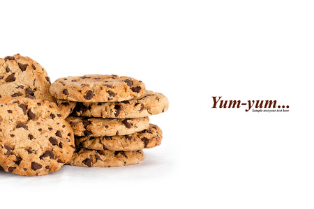 white yummy: Lots of yummy freshly baked crunchy homemade chocolate chip cookies isolated on white with copyspace for text Stock Photo