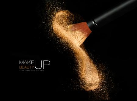 cosméticos cepillo suave liberación de una nube de polvo de la cara brillante brillante sobre un fondo negro con espacio de copia en un concepto de belleza y maquillaje