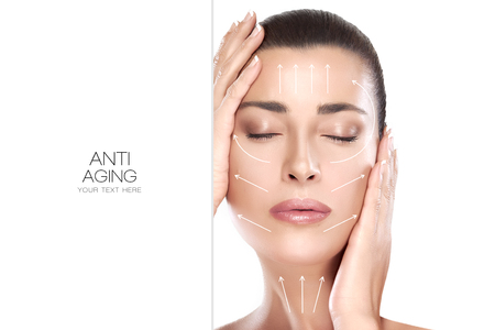 Head shot of beautiful model with hands on face and closed eyes with a serene expression suitable for anti aging treatment and plastic surgery concept. Foto de archivo