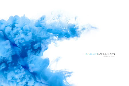 Closeup of a colorful blue acrylic ink in water isolated on white with copy space. Template design. Abstract background. Color explosion. Paint texture.