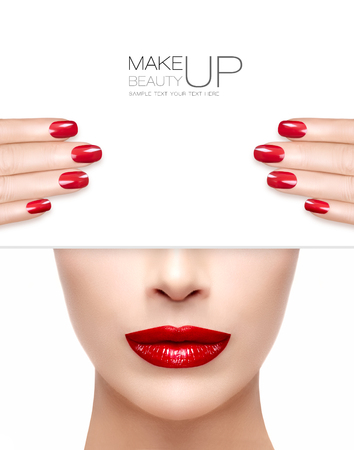 Beauty Makeup and Nail Art Concept. Beautiful fashion model woman with trendy red lipstick to match her manicured nails, half face with a white card template. High fashion portrait isolated on white