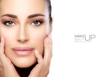 Beauty Makeup and Nai Art Concept. Beauty model woman with soft pink smoky eye makeup, foundation on a unblemished skin and trendy pink lipstick to match her manicured nails. High fashion portrait isolated on white with copy space for text