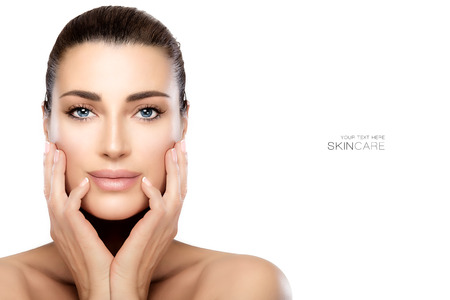 Beauty model woman with hands on cheeks looking at camera with a serene expression in a beauty, skincare and spa concepts. Perfect skin with no makeup makeup and manicured nails. Portrait isolated on white with copy space for text. Standard-Bild